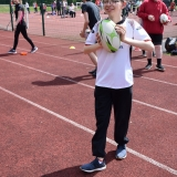 Photograph of a pupil about to pass a rugby ball