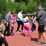Photograph of pupils and staff during a game of tag rugby