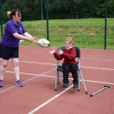 Photograph of a staff member throwing a rugby ball to a pupil
