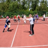 Photograph of pupils passing a rugby ball
