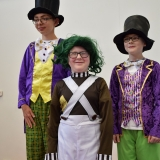 photograph of three pupils in their charactor outfits