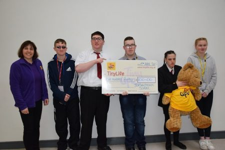 6B present Tiny Life Charity with a cheque for £100