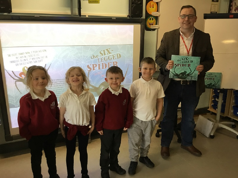 Photograph of local author with pupils