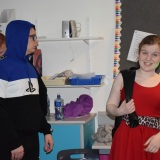 Photograph of two students performing in the fashion show