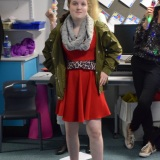 Photograph of student  performing in the fashion show