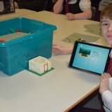 Photograph of a pupil making an animation movie using a school iPad and the Stickbot app