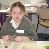Picture of a pupil with the clay butterfly they made