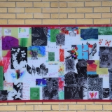 Picture of the first large colourful mural fix to a wall in the Primary playground
