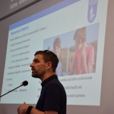 Picture of a member of Guide Dogs during their presentation at the conference