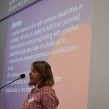 Picture of a member of SENSE during their presentation at the conference