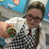 A pupil with their finished Christmas bun