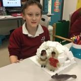 Pupil making igloo