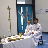 Picture of two pupils beside the communion table