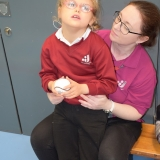Picture of a pupil looking at a ball use in hurling