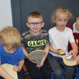 Picture of pupils looking at a hurling sticks