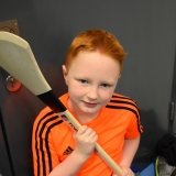 Picture of  a pupil looking at a hurling stick