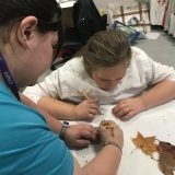 Picture of a staff member and a pupil working in the Art room during Hallow Green day