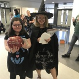 Picture of a staff member and a pupil in fancy dress during theHallow Green day