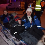 Staff and pupils on a sledge