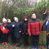 Photograph of Alderman John Smith  and  the pupils in the nature reserve