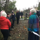 Photograph of Mrs Joan Christiea nd the pupils in the nature reserve