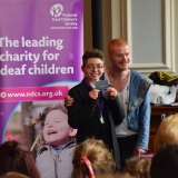 Photograph of pupil receiving  their prize