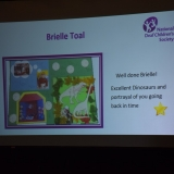 Photograph of powerpoint slide with the  pupil's art work and text of what the judges said