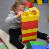 Picture of a pupil building large coloured blocks