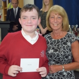 Photograph of a pupil after receiving their prize  from the special guest