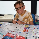 Picture of a pupil designing a advertising poster for chocolate