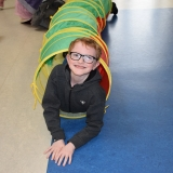 Picture of a pupil appearing from a fun tunnel