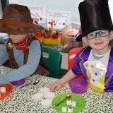 Picture of two pupils making chocolate sweets