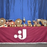 Photograph of the special awards on a display table with the school logo on the front