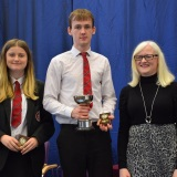 Photograph of Ms Rosaleen Dempsye and two pupils with their special awards