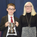 Photograph of Ms Rosaleen Dempsye and a pupil  with their special awards