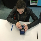 Picture of a pupil safely using a card machine