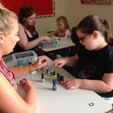 Pupil having their nails painted