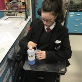 Photograph of a pupil performing a science experiment