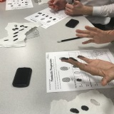 Photograph of pupils taking fingerprints