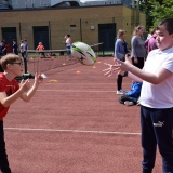 Photograph of two pupils passing a rugby ball to each other