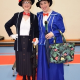 Photograph of  two staff in their charactor outfits